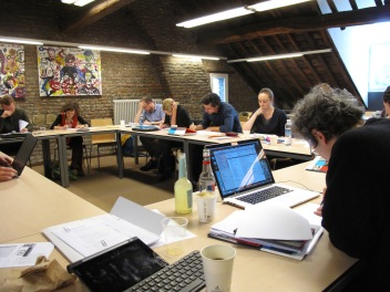 1. Participants labouring over an extract from a holiday sales call brought by Rein Sikveland.JPG